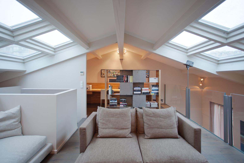 Tre appartamenti sovrapposti diventano un loft for Quanto costa costruire appartamenti