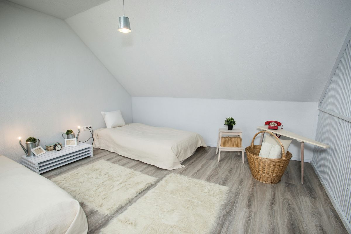 attic-bedroom-area-rugs-and-accent-furniture