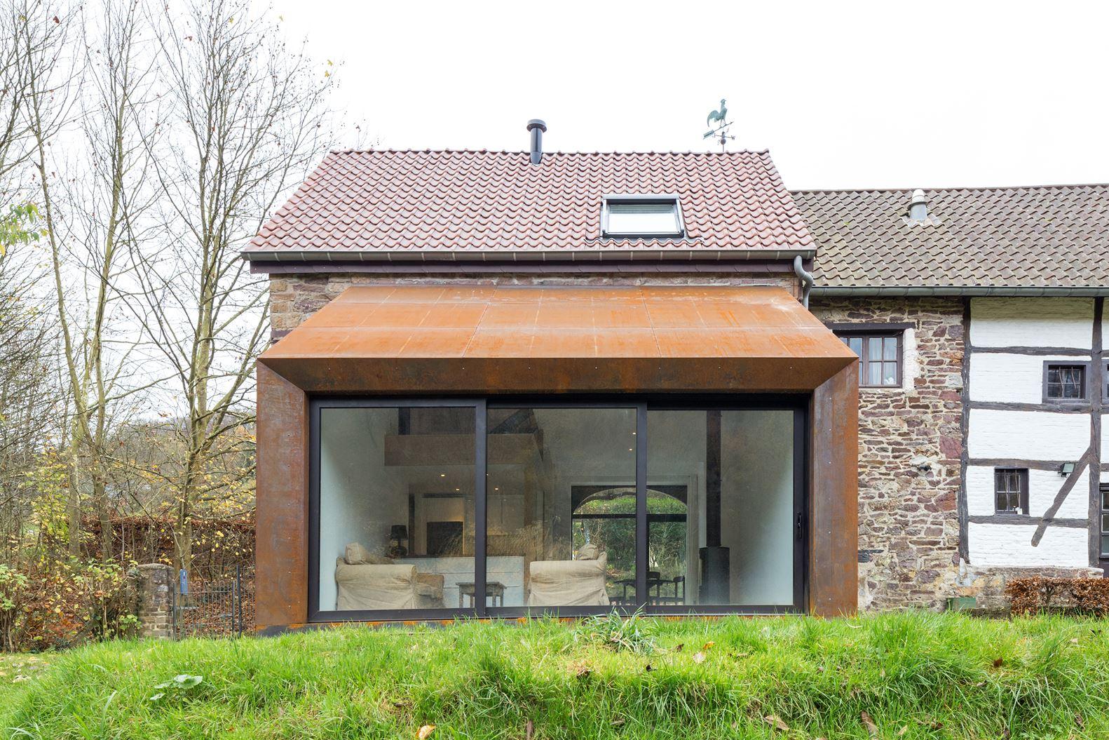 Ristrutturazione e ampliamento di una casa rustica for Piani di casa vacanza rustica