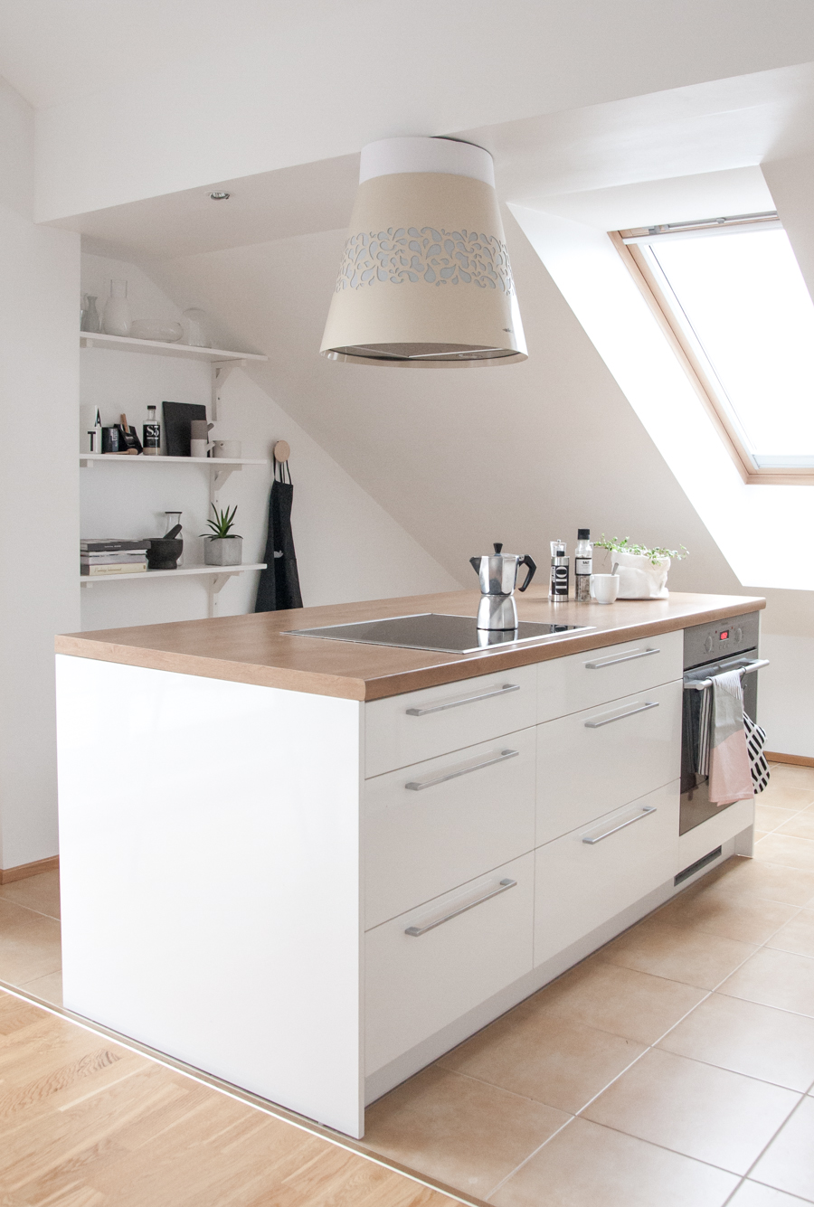 white-nordic-kitchen-with-a-sloped-ceiling