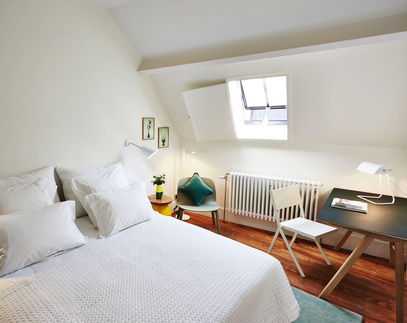 Un hotel con suite in mansarda for Planimetrie per aggiunta suite in legge
