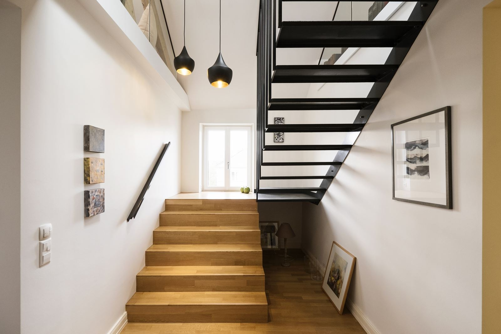 Una casa su due livelli con zona giorno in mansarda - Mansarda.it